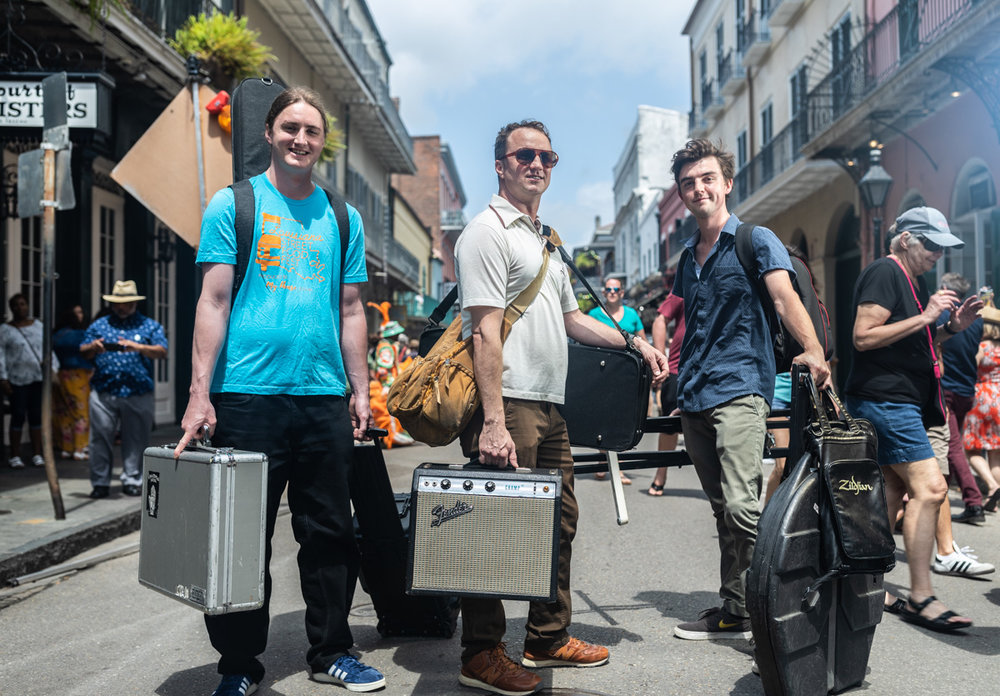 Bryan, Louis, and Kirkland are seen lugging their gear to the Michot Melody Makers set. Hard workers. (Period) ©Zack Smith Photography