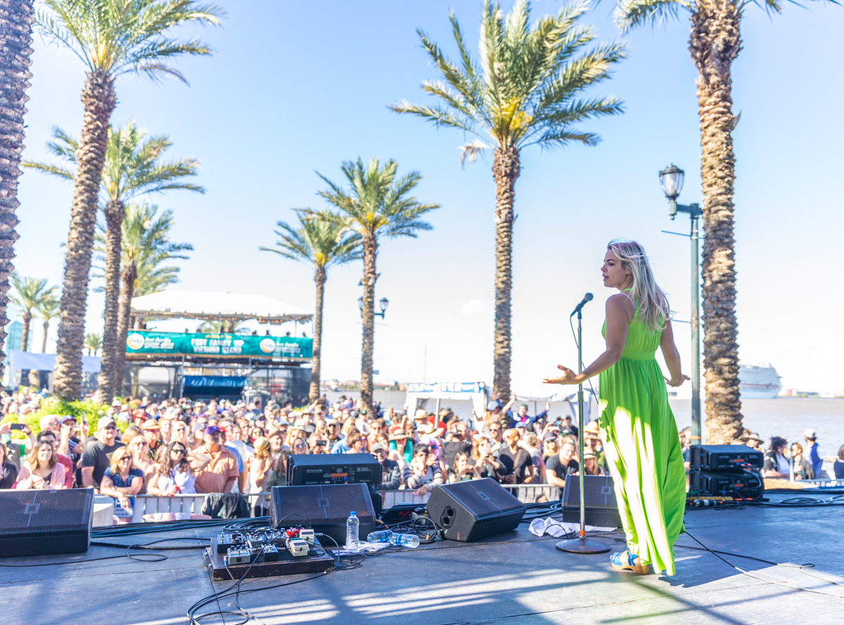 Maggie Koerner performs at French Quarter Fest amongst a sea of fans and the Mississippi River. ©Zack Smith Photography