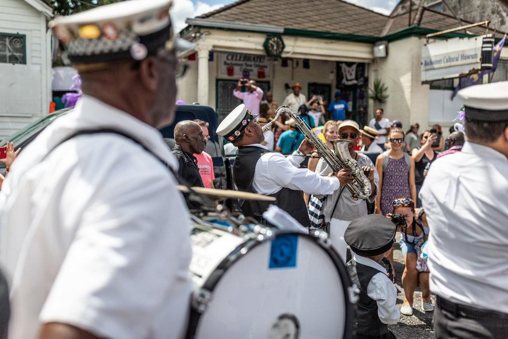 The Treme Brass Band blows hard, giving props to Sylvester Francis at the Backstreet Cultural Museum.