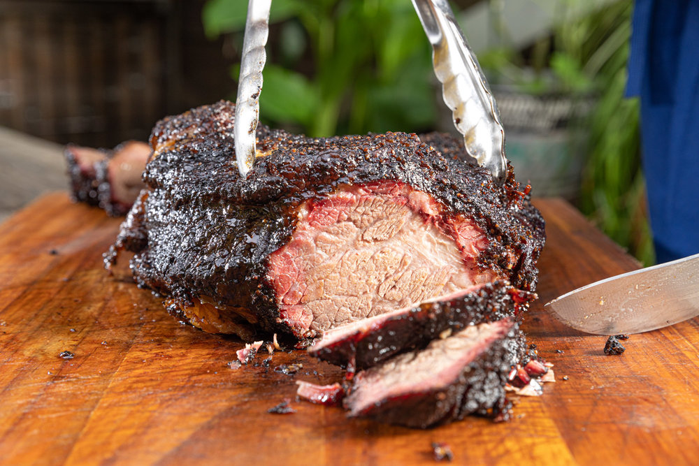 Now that's a piece of meat. The Joint owner Peter Breen cuts into a slice of brisket.