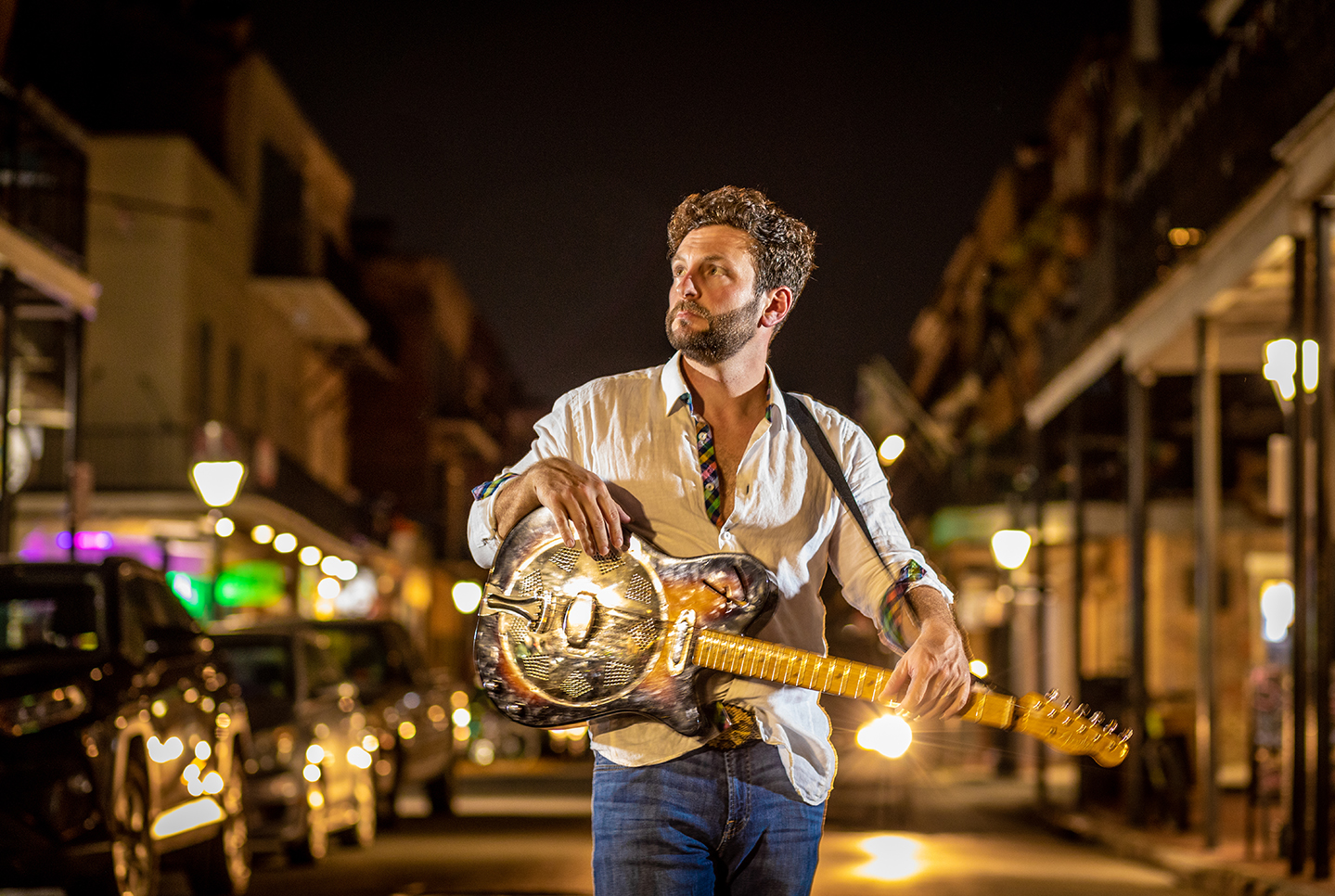 Guitarist and singer Harry Barton of The New Orleans Johnny's on Decatur Street. 2019.