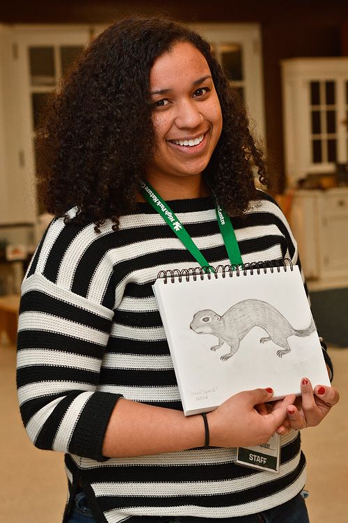Chantale and her drawing of a Ground Squirrel.
