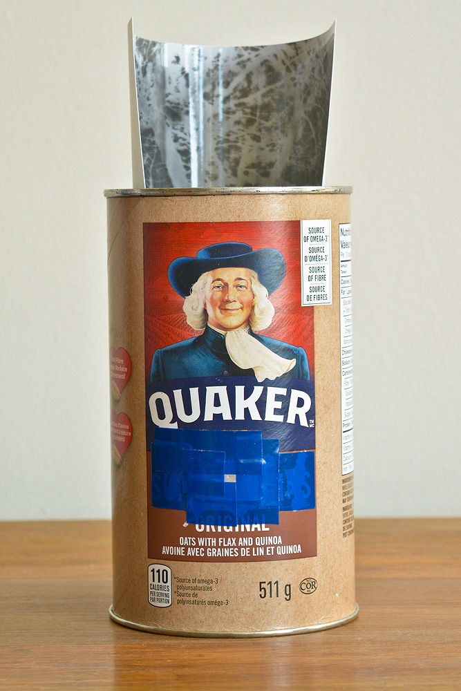 An oatmeal container that's been transformed into a pinhole camera!.