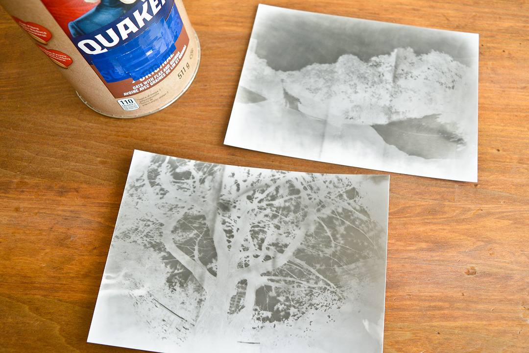 Paper negatives after they've been developed in a darkroom.