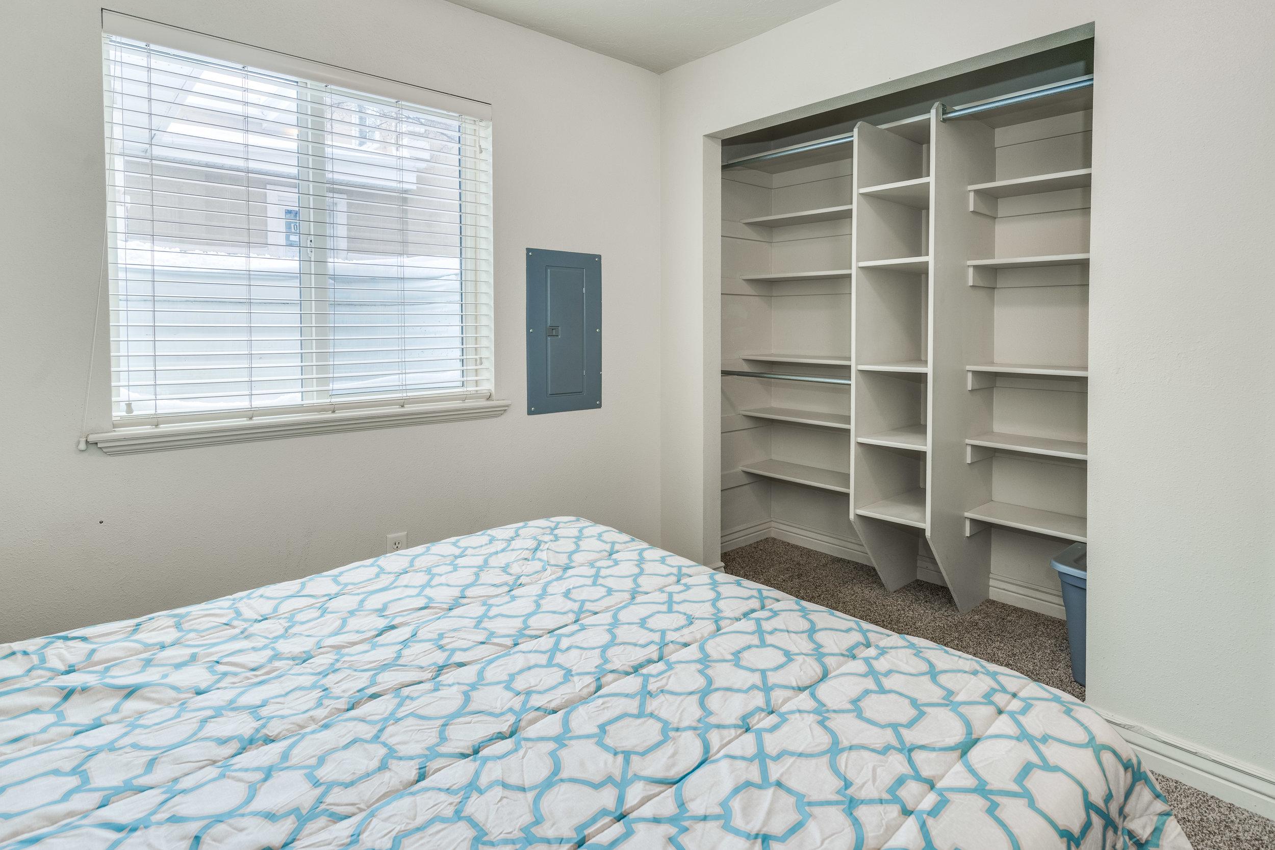 Plenty of extra storage in the bedroom closet.