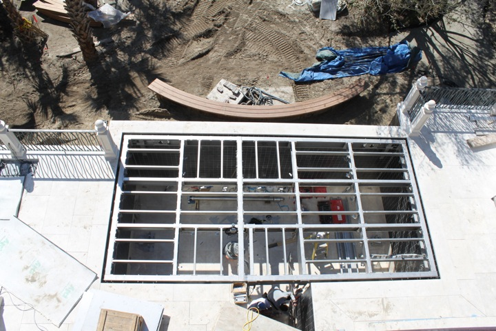 Bird's eye view of the same. The rigid stainless steel structural system is locked in the flush position.
