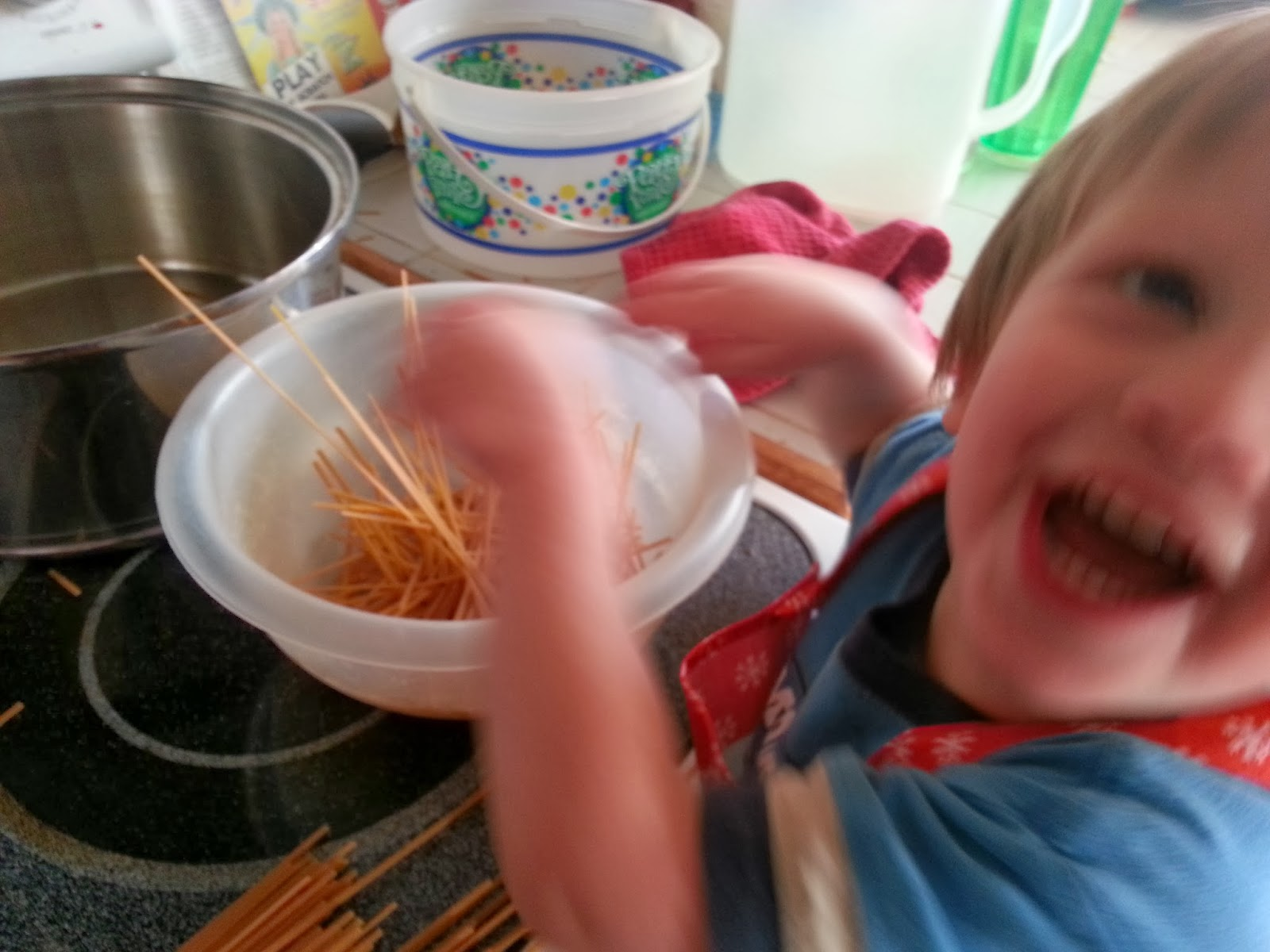 My 2 year old has to help cook every meal. Here is breaking up the noodles for the soup. I know this picture is a bit blurry but it totally expresses his joy for cooking.