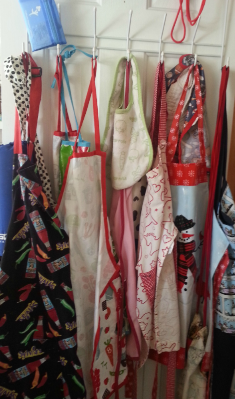 We have SO many aprons. To keep them all straight, everyone gets a peg on our pantry door.
