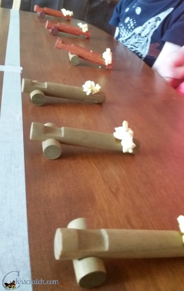A popcorn catapult game- love this Popcorn Games event to do with the family. Would be great for Family Night or a church activity night #teachlikeachicken #FamilyNight #FHE