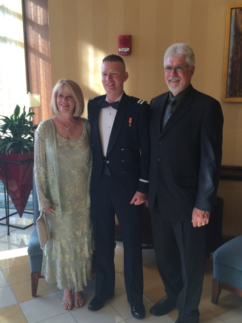 Tanner with his mother and father