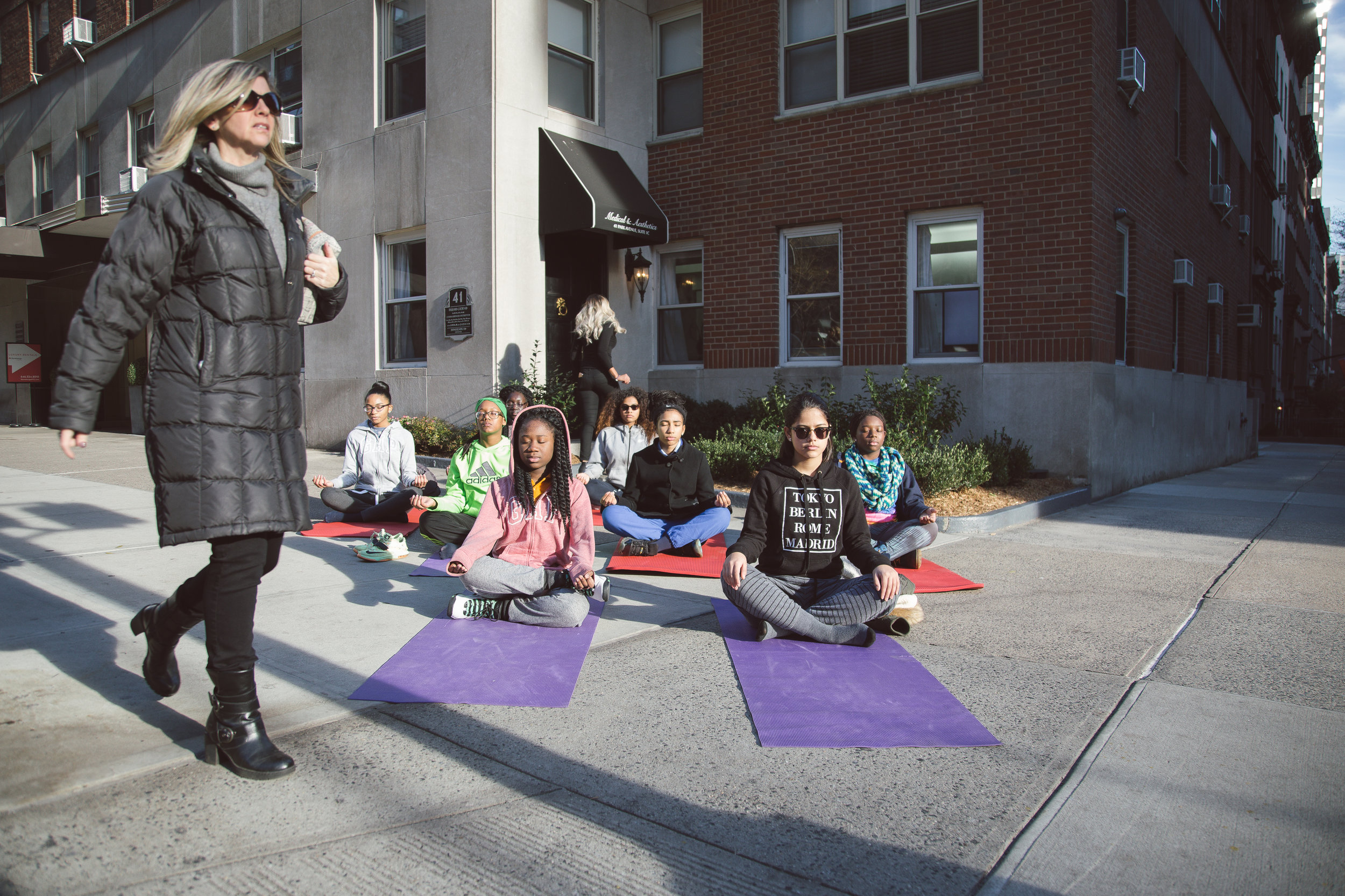 Being able to quiet your mind, and focus inward is a life skill in NYC.  Here my students take their studio practice to the streets as they focus inward and meditate outside.