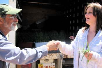 Onion project advisor Farmer Daniel takes delivery of 6,000 onion sets for Cerro Vista Farm (largest local CSA)