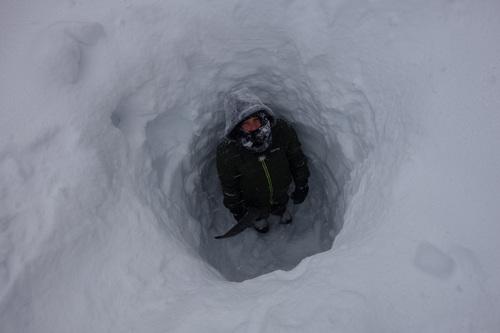 Syd Slater studies the snowpack depth