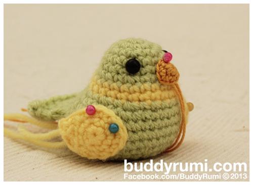 Cute amigurumi green and yellow bird crochet