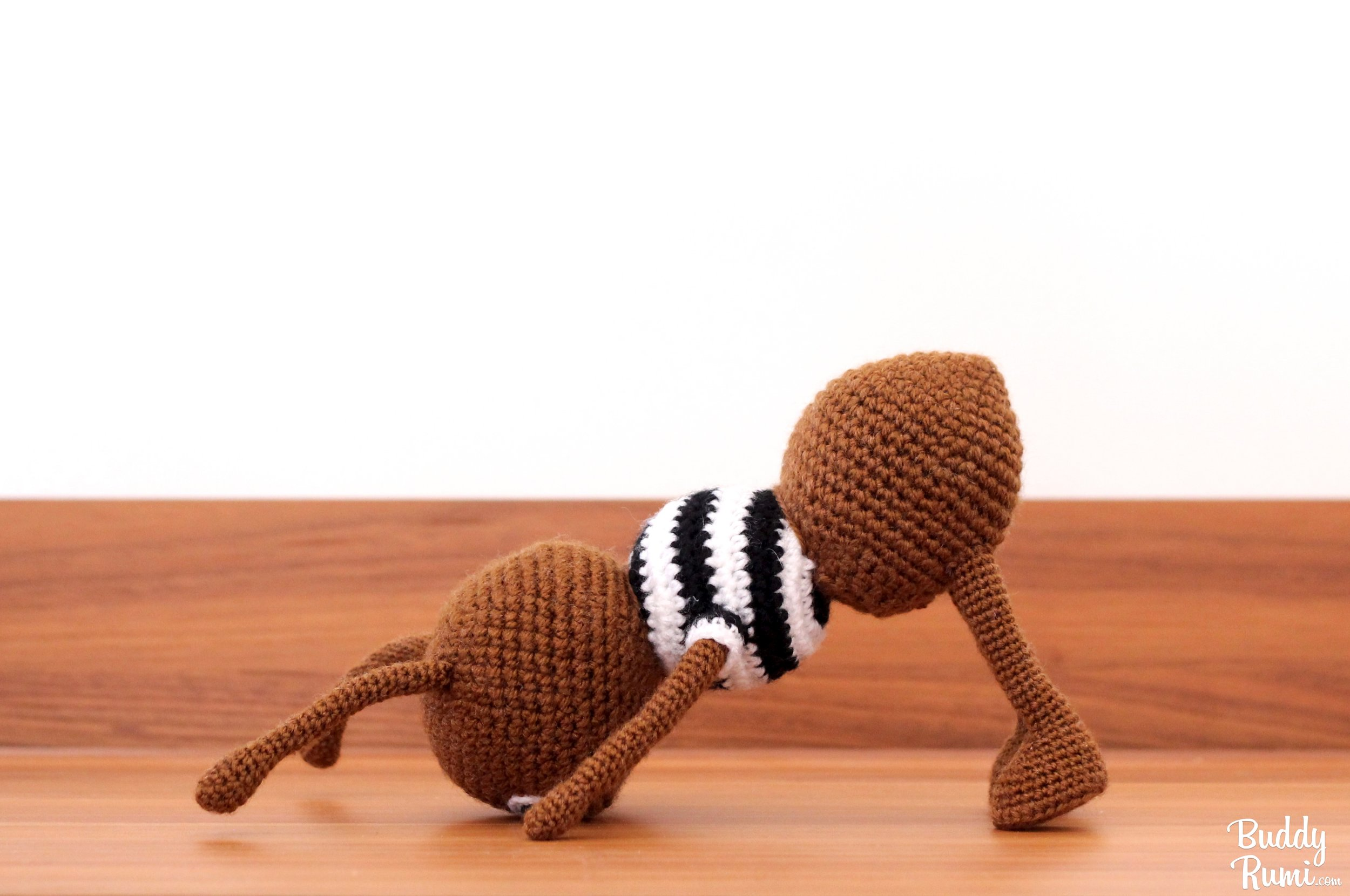 Crochet ant in downward facing dog