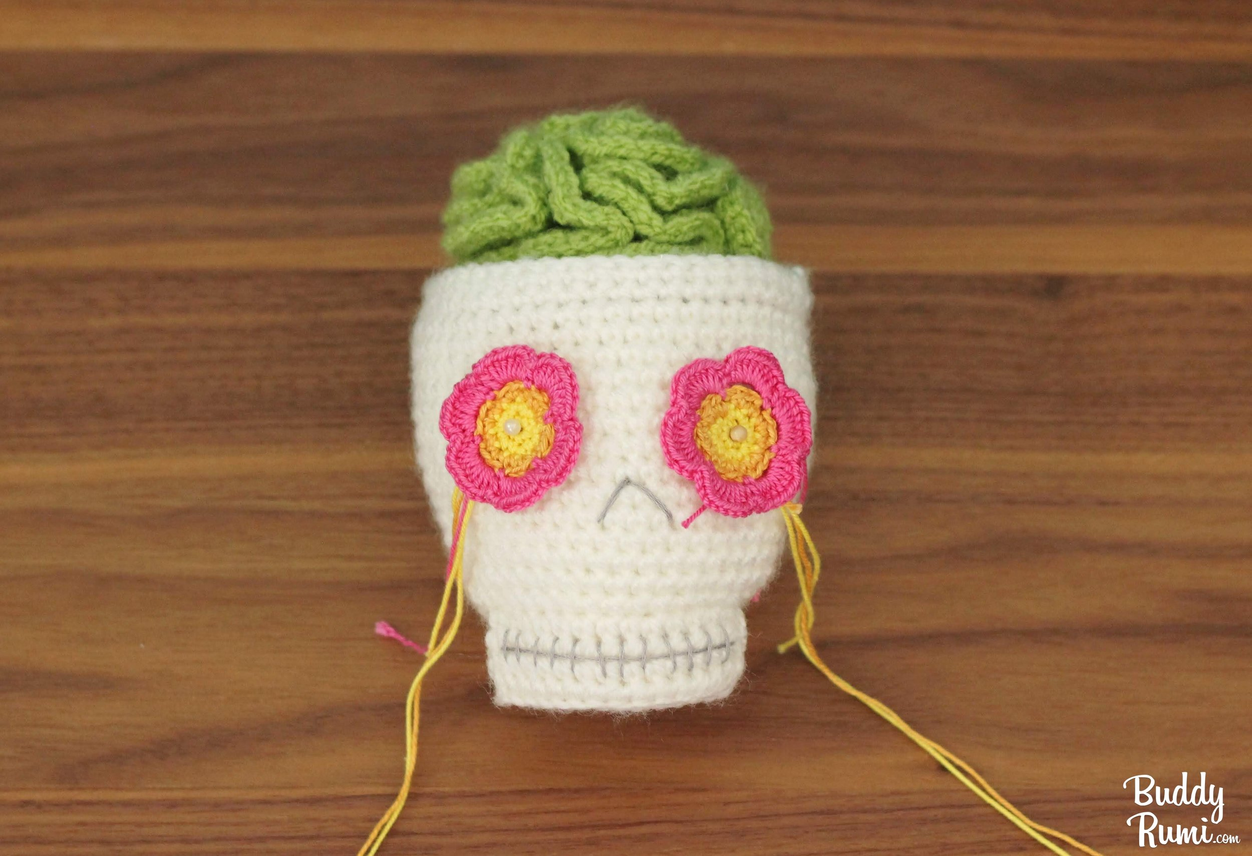 Amigurumi crocheted brain cactus in skull