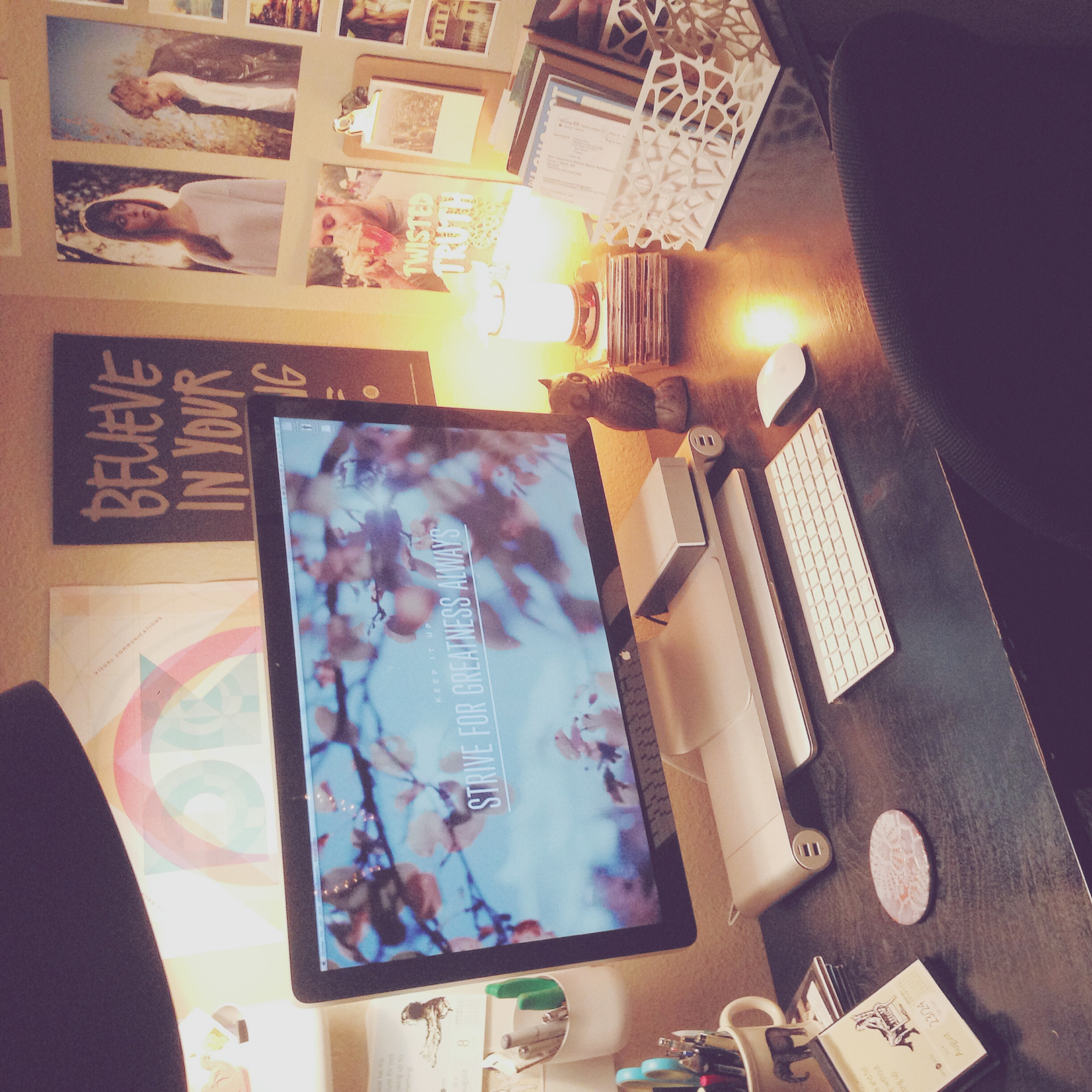 A view of my slightly-cluttered, but totally cozy workspace at home.