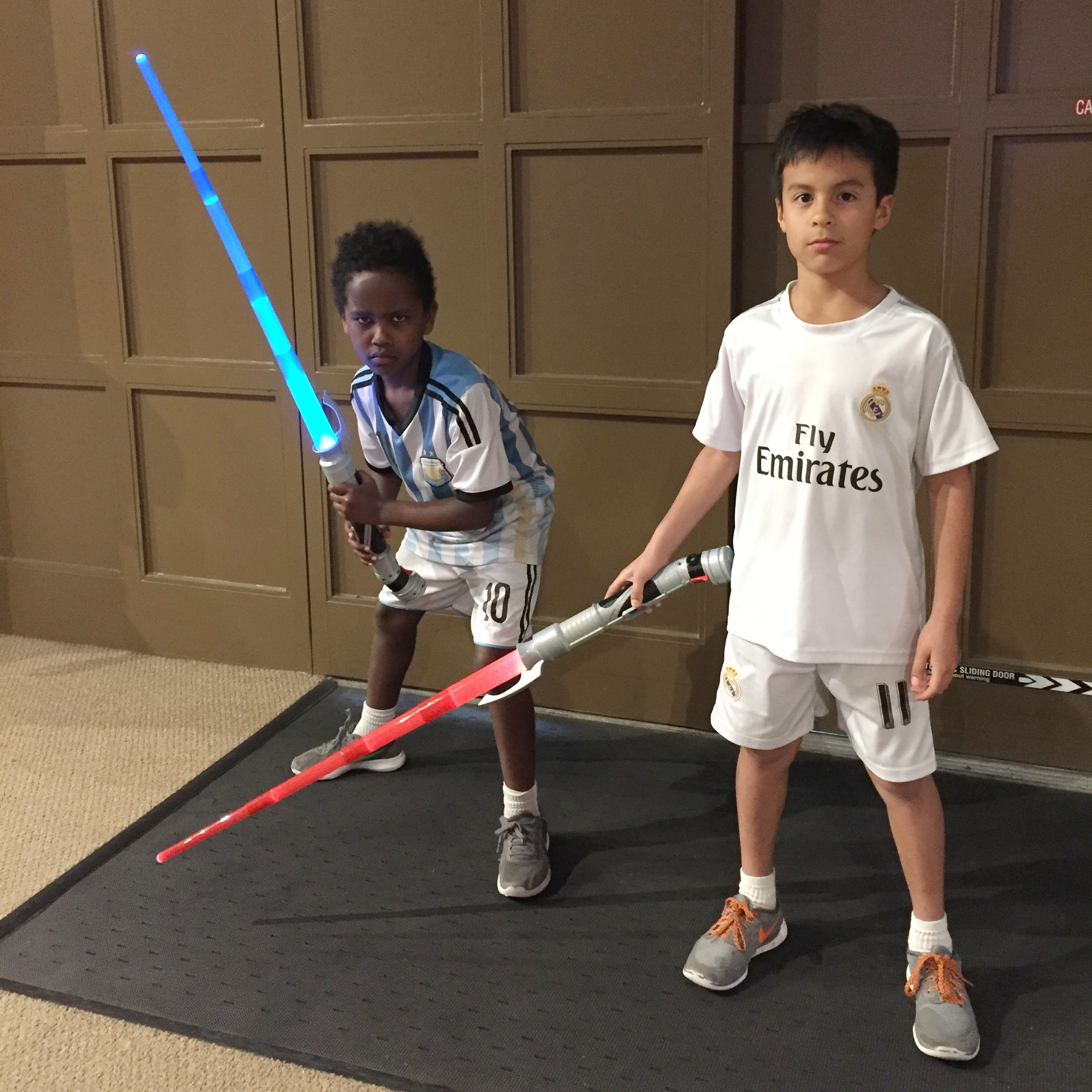 In a typical moment in David's household, his two boys prepare for battle.