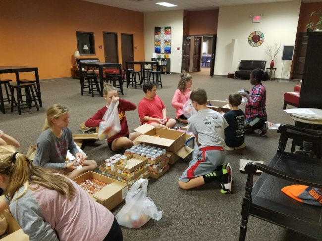 filling food bags for Coralville Central Elementary