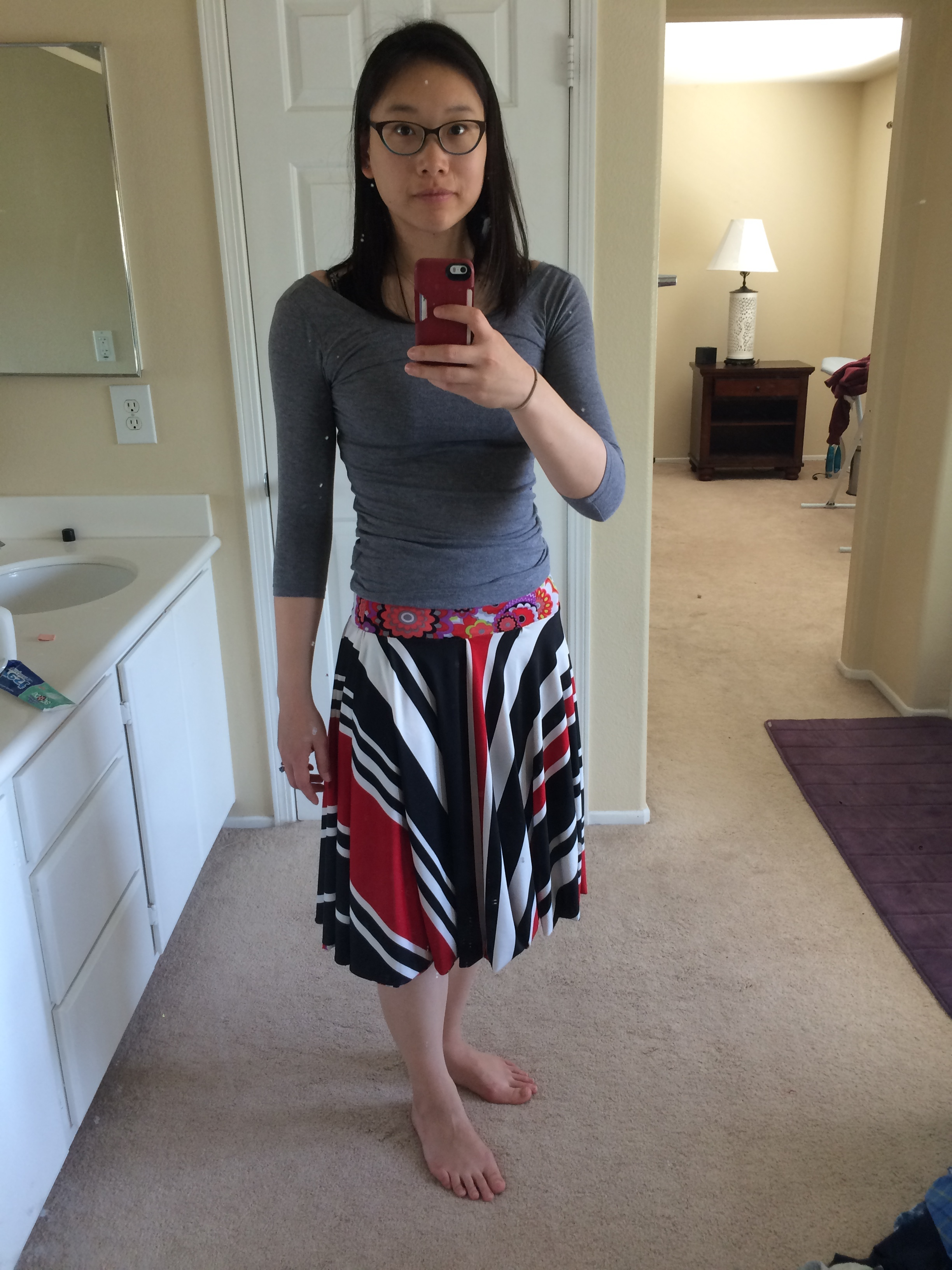 Black, red, and white striped side of the skirt with contrasting floral waistband