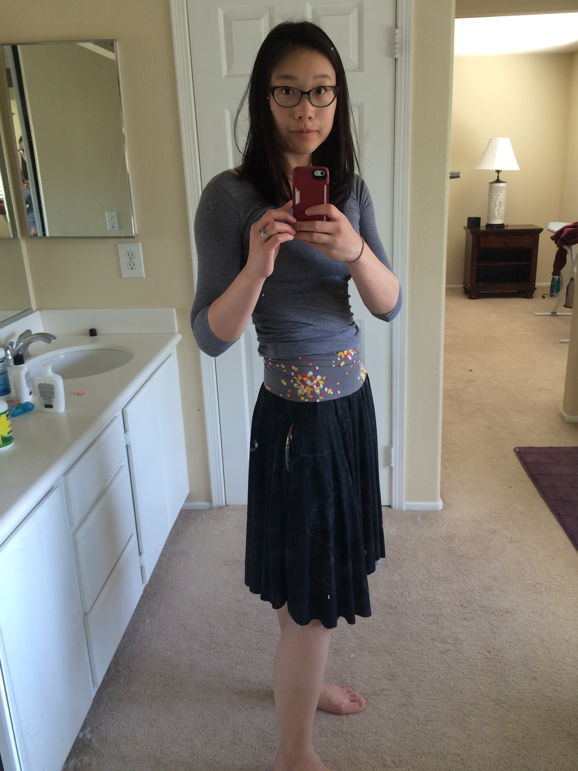 Black floral side with contrasting waistband. It's hard to tell in the pictures, but there are subtle flowers outlined in gray on the black side.