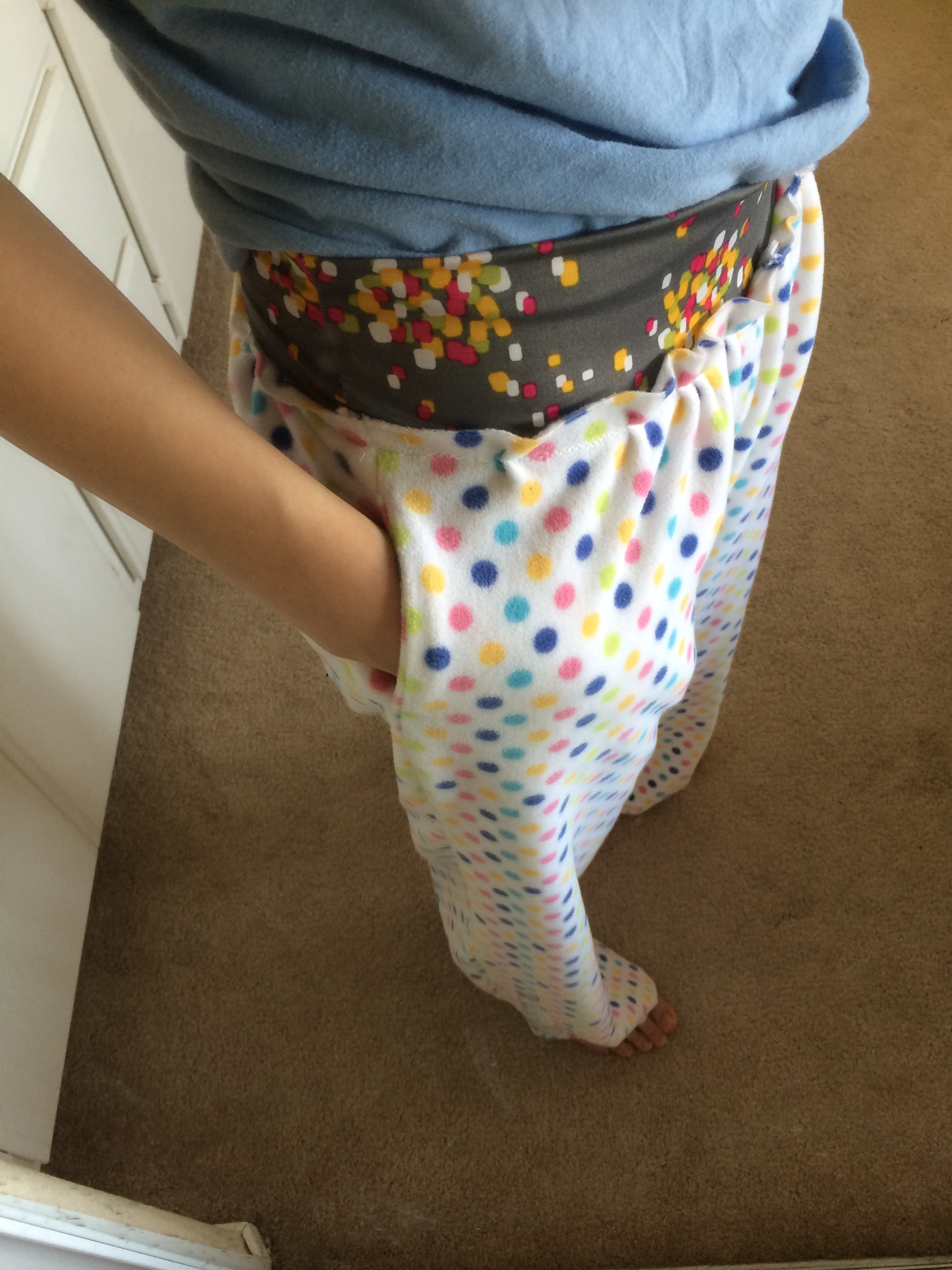 Showing off the pockets, I love pockets! The waistband is the same gray confetti that I used for my skirt. My husband keeps thinking that I'm wearing a skirt under my pajamas!