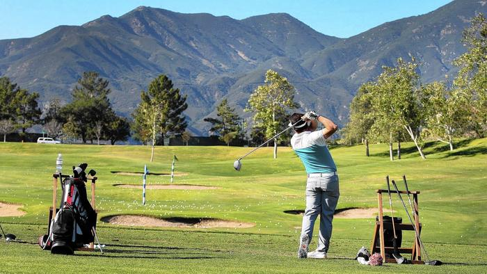 Brent Meschuk practices his swing at the driving range overlooking Saddleback Mountain at the Dove Canyon Golf Club.