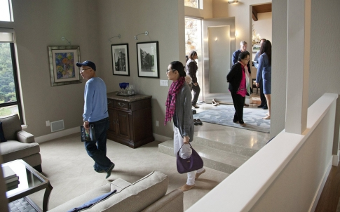 Chinese cash-bearing homebuyers tour a house in California.