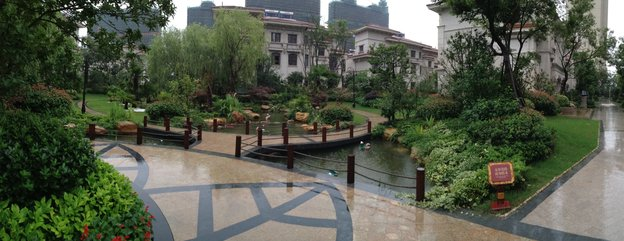 Villas in a luxury compound in Wuxi, in China's eastern Jiangsu province, sit empty after a year while more apartment blocks rise in the distance.