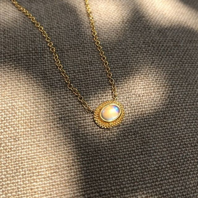 """A magical cabochon Moonstone set in hand-granulated 22 Kt Gold🌙☀️⠀ 🌙Pendant is fixed on a 17"""", 18 Kt Gold link chain🌙⠀ Link in bio...⠀ .⠀ .⠀ .⠀ .⠀ .⠀ .⠀ .⠀ .⠀ #ancientmodern #celestial #handgranulation #handmade #22kt #moonstone #juliuscohen #madeinnewyork"""
