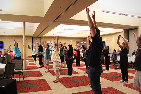 Erin Hollenbeck, Certified Autism Movement Therapy Instructor, leads attendees in an Autism Movement Therapy demonstration.