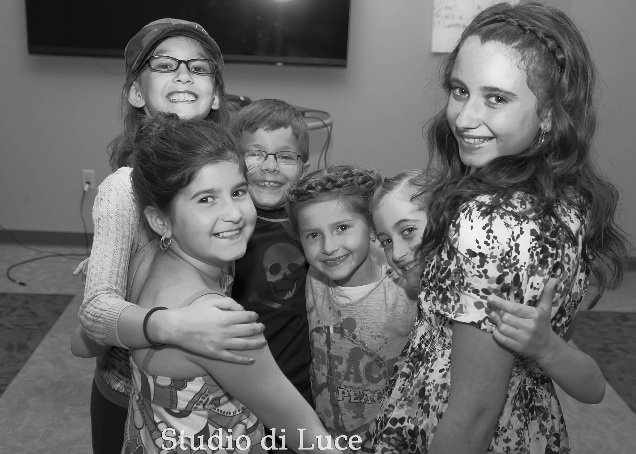 The child models hanging out backstage.
