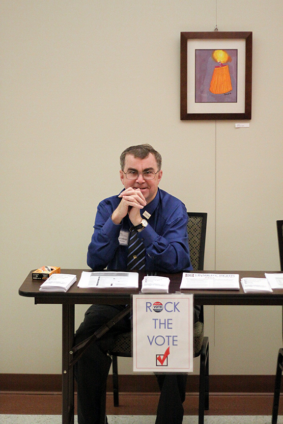 Doug, Public Relations Officer, reminds his fellow conferees to vote!