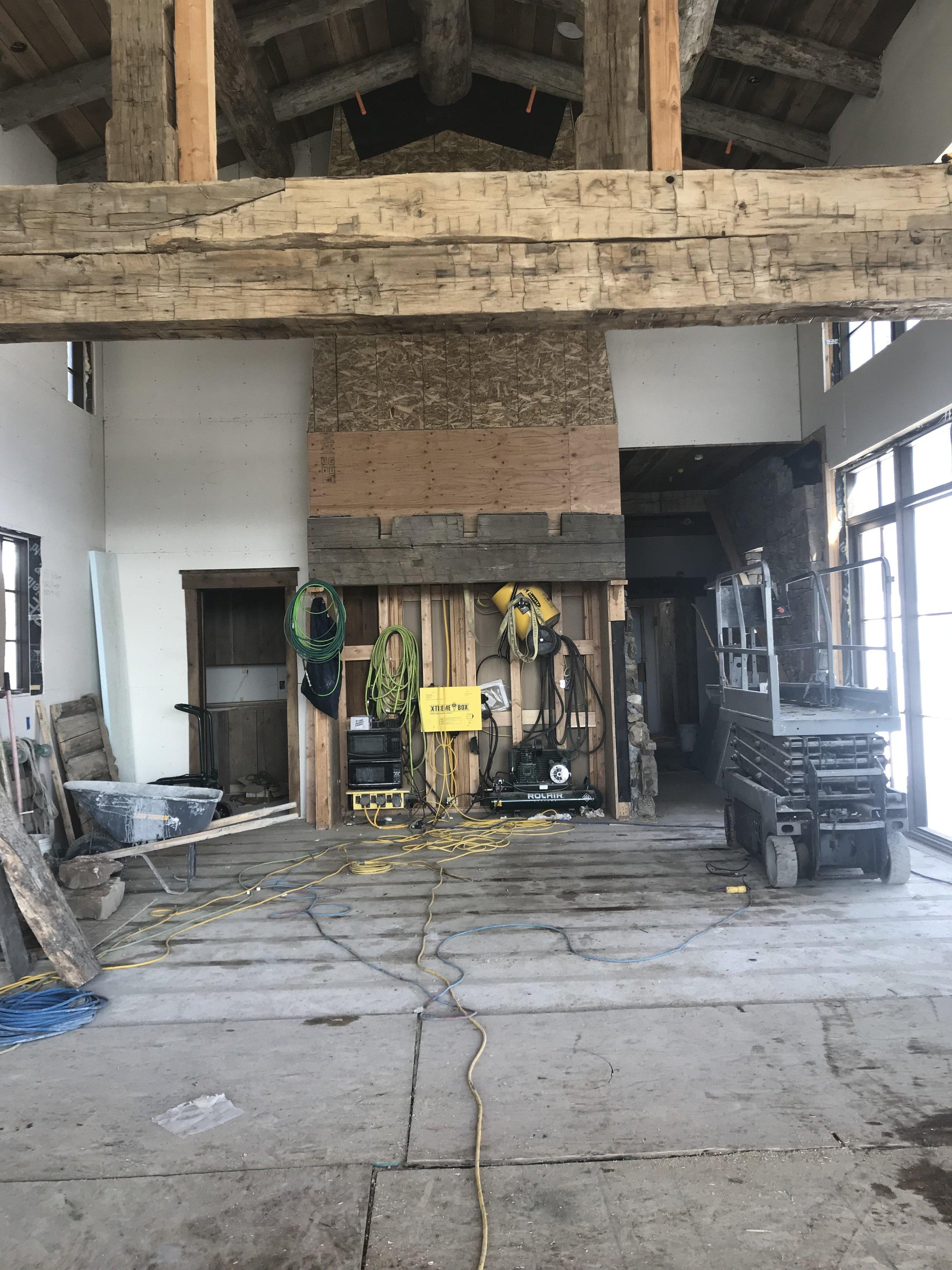 Yellowstone Club Montana Custom Home Design Central Living Area Reclaimed Wood Beams and Custom Fireplace.jpg