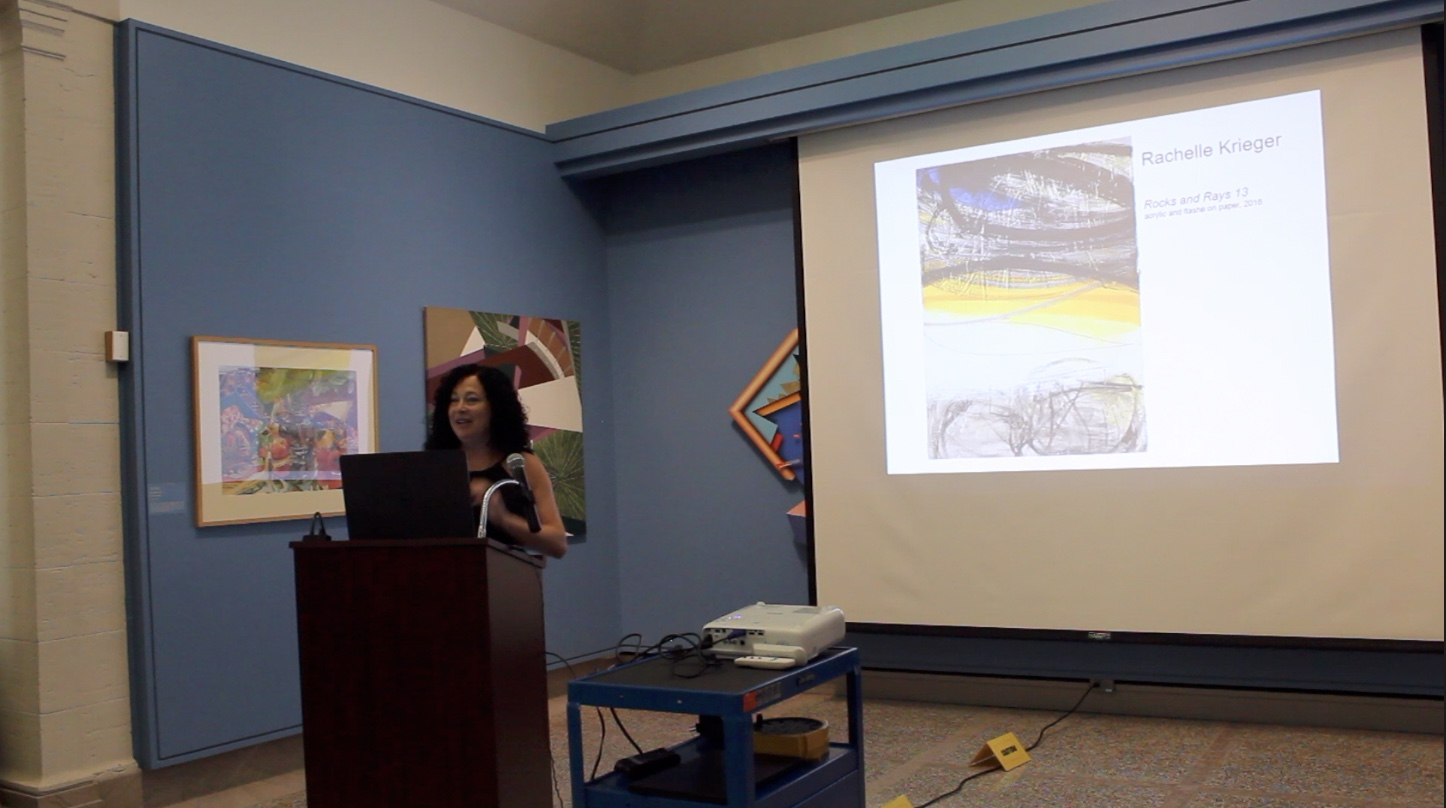 Krieger presenting about creative process and recent paintings