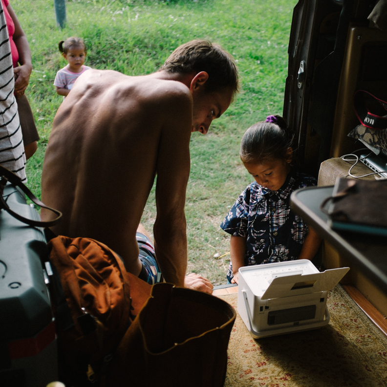 Aidan printing off a portrait for a little girl in Belmopan, Belize's capital.
