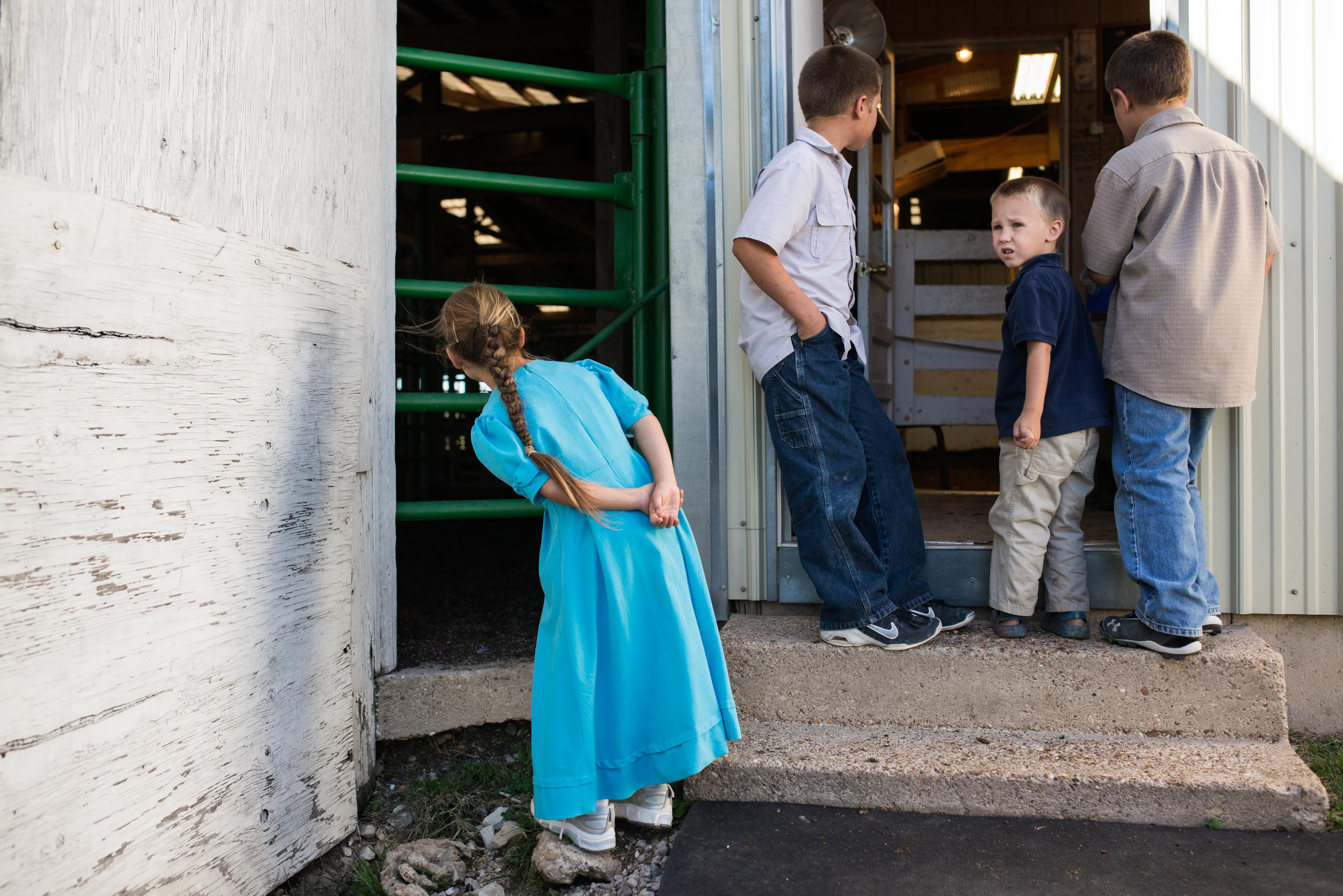Outside the holding pens of the Interstate Regional Stockyards in Cuba, Brittney, Austin, Travis and Trevor Mast, wait for their cattle to enter the auction house for the day's sale. Nathan has been breaking into the regional cattle market.