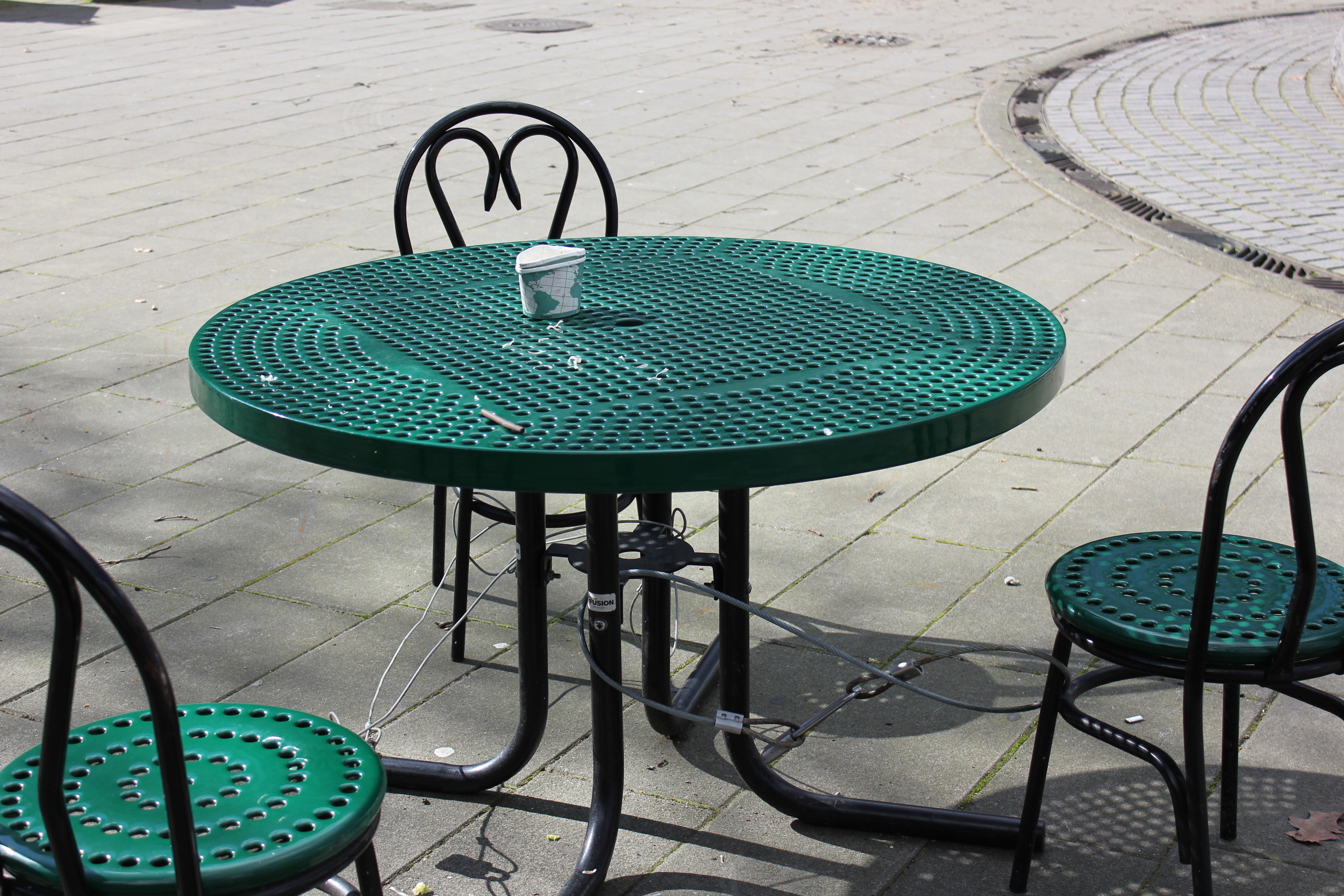 Chairs and tables chained to the ground in Tilikum Place.