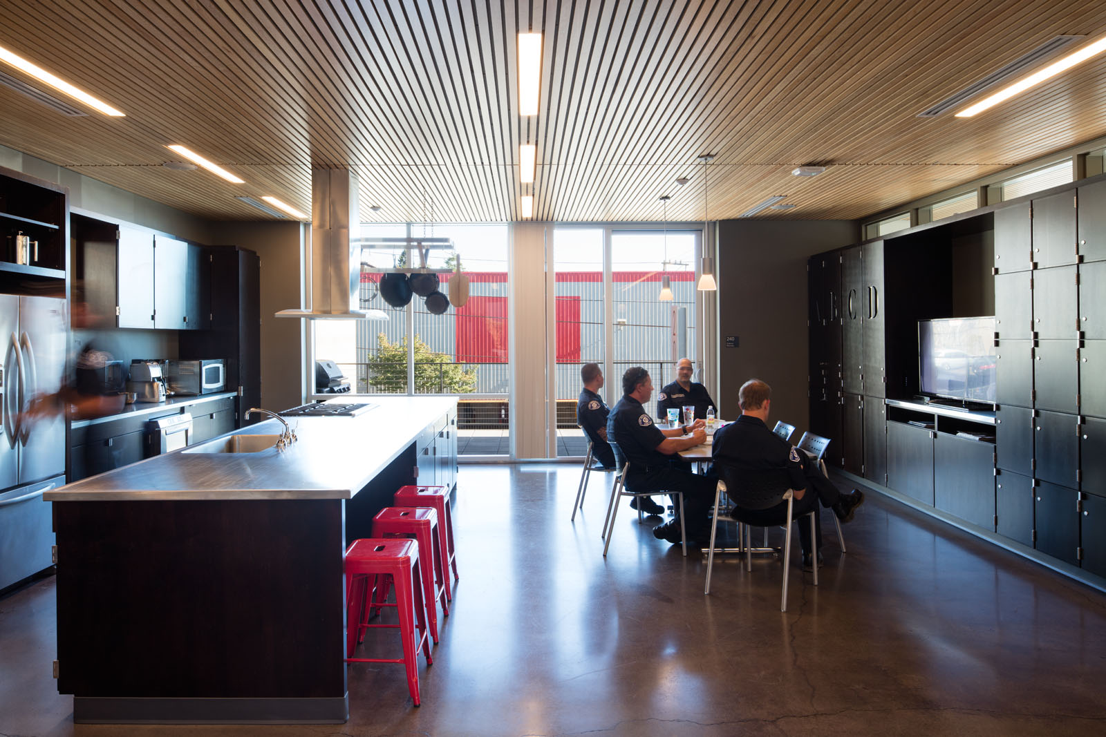 The kitchen and dining space. Photo by Lara Swimmer, courtesy of Schacht Aslani Architects.