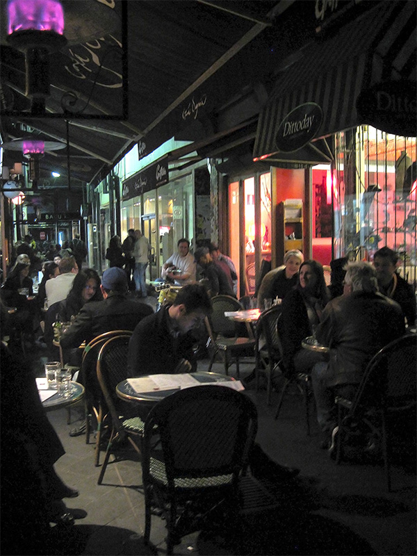 Into the evening, Block Place is bustling with people sitting at one of the cafes spilling into the laneway. Musicians contribute to the atmosphere. Photo by Sarah Oberklaid.