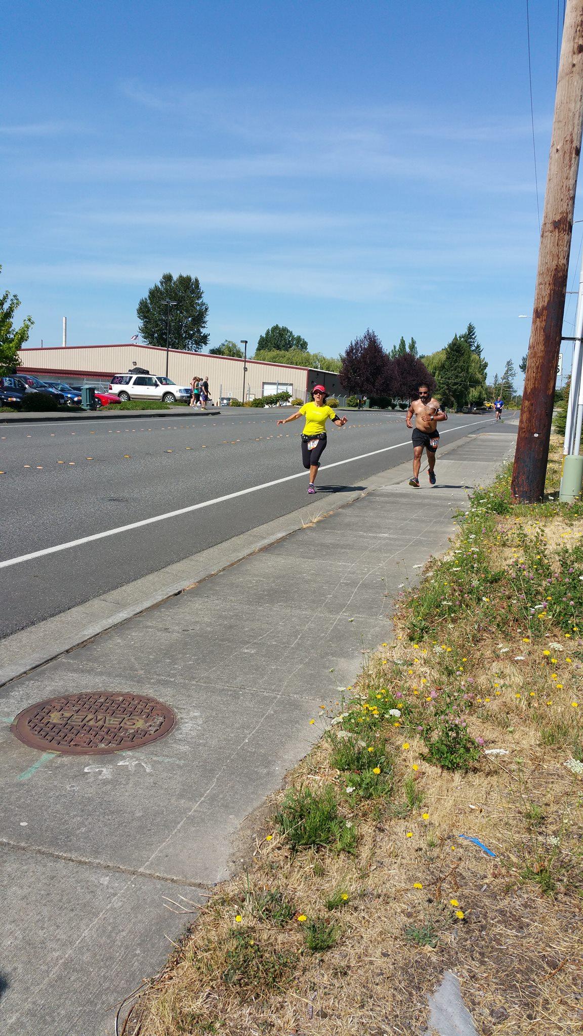 Donna running with hottie on 1st leg.jpg