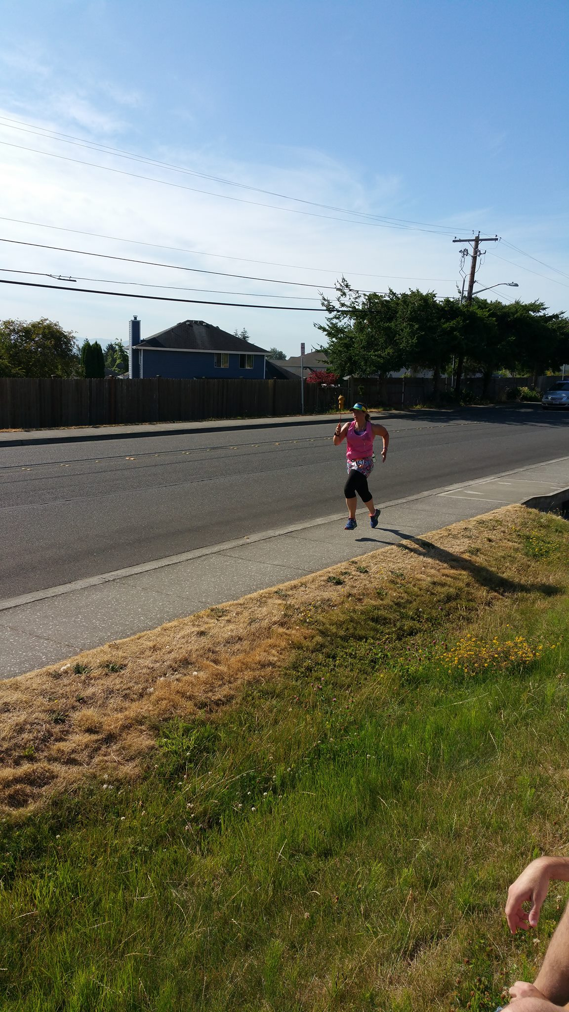 Emily coming into the finish of leg 1.jpg