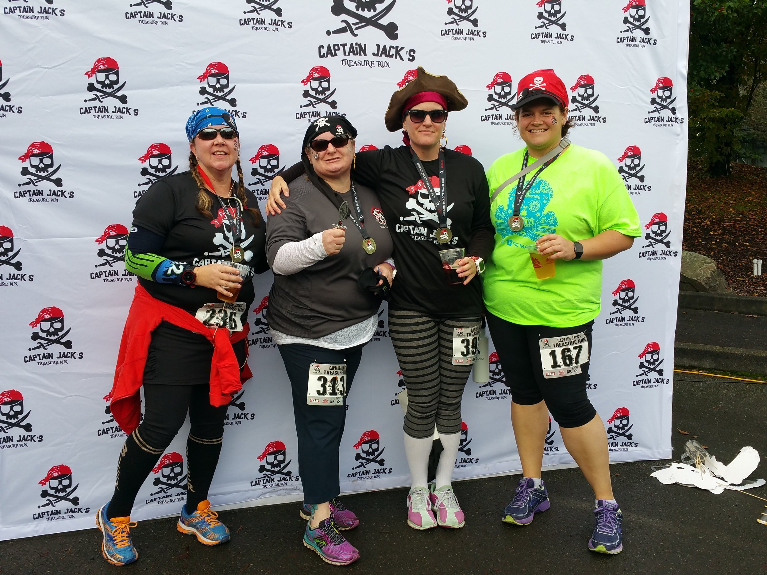 Some of the Pip Runner's with me at Captain Jack's. I may have turned down candy yesterday but I couldn't turn down the free beer at the race.