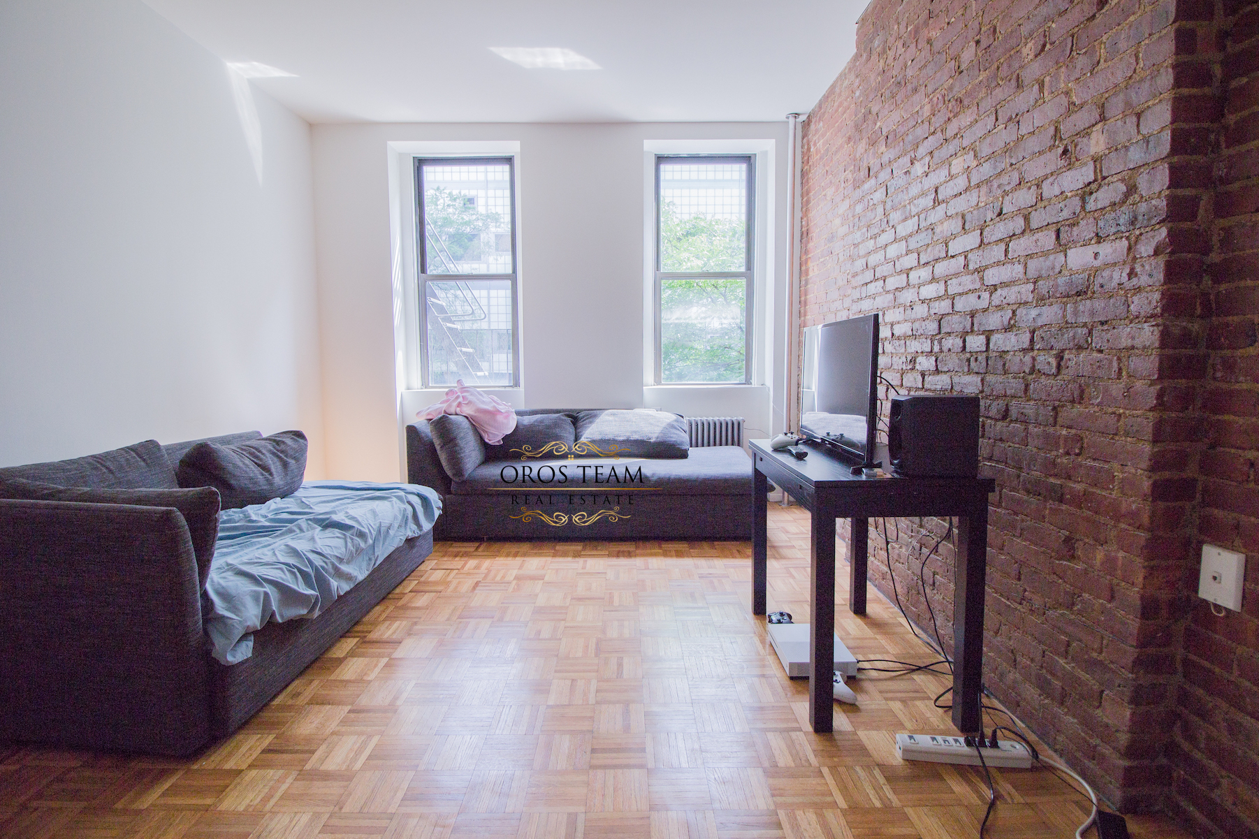 411 West 50th Street #2B - Nicely Renovated Kitchen with stainless steel appliances and microwave, newly renovated bath, hardwood floors, exposed brick and high ceilings. Southern exposure provide great light. Sorry, no pets or smoking.Rent: $1,950 /monthTerms: 12 - 12 MonthsAvailable: July 1st