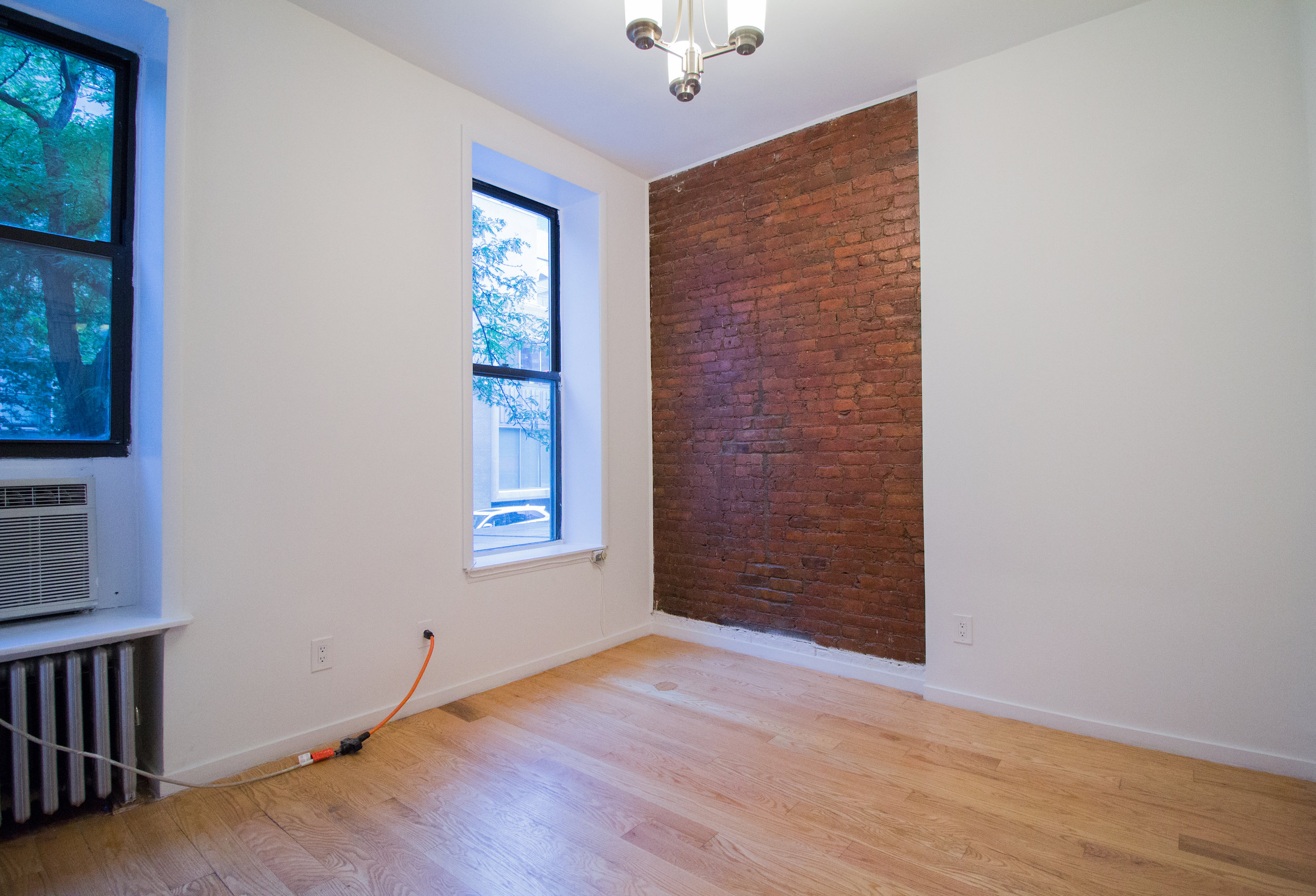 41 St. Marks Place #2 - Spacious Two Bedroom on St. Marks Place in East Village! Enjoy great size living space, separate kitchen and charming exposed brick. Each bedroom fits easily queen size beds with extra furniture! Located on a first floor of a well maintained & secured building right on St. Marks place and 2nd Ave. Live in the prime area filled with restaurants, shops, stores, entertainment and near subway lines such as N, R, 6, L lines and other public transportation.*Pets allowed case by case* Contact us to schedule a showing!Rent: $3,195 /monthTerms: 12 - 12 MonthsAvailable: Immediate