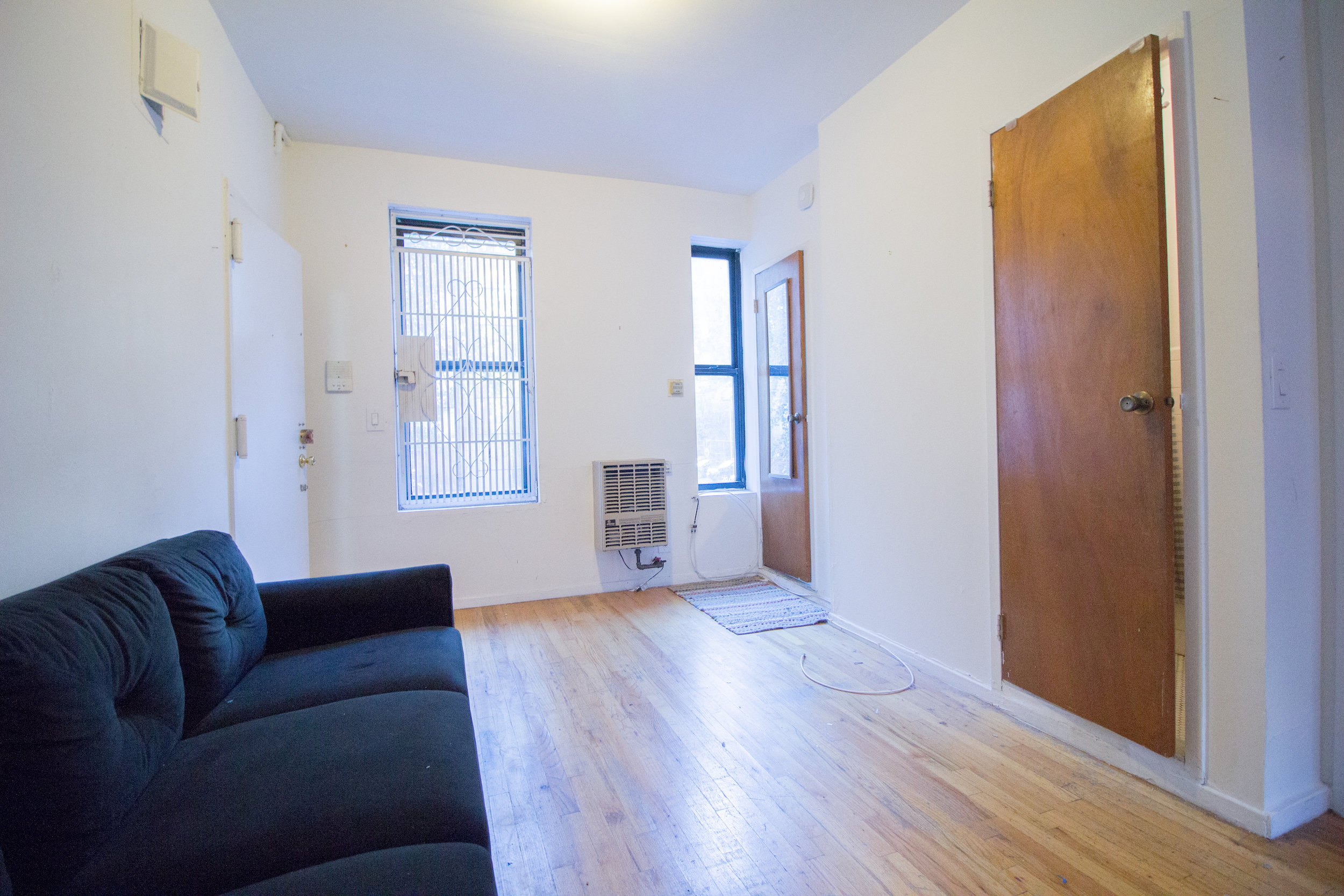 443 E 6 Street #2 - New Spacious Junior-4 in East Village!Good deal for a bright apartment with separate windowed kitchen, spacious sleeping area as well as a large living space, hardwood floors throughout and deco fireplace with exposed brick for a charm! Located just one flight up the stairs in a walk up building right on a tree line street in East Village, steps away from major restaurants, stores, entertainment, parks and several subway lines. Rent: $1,950 /monthTerms: 12 - 12 MonthsAvailable: Immediate