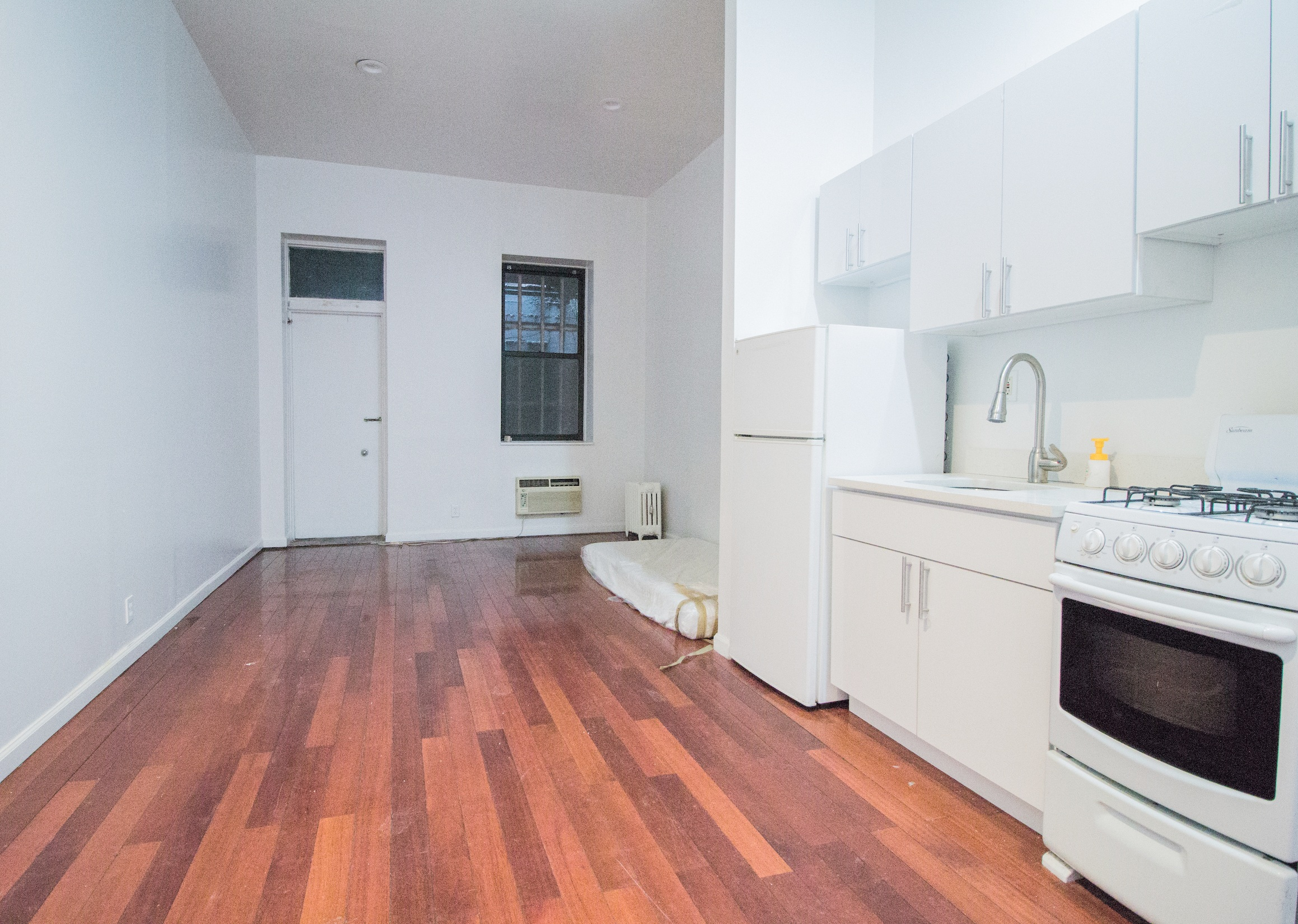 215 Ave A #1RS - Spacious Studio in East Village!Renovated studio offers gorgeous hardwood floors, open kitchen and large closet. Located on a ground floor in a walk up building that is closet to public transportation, great restaurants and shops.Rent: $1,900 /monthTerms: 12 - 12 MonthsAvailable: Immediate