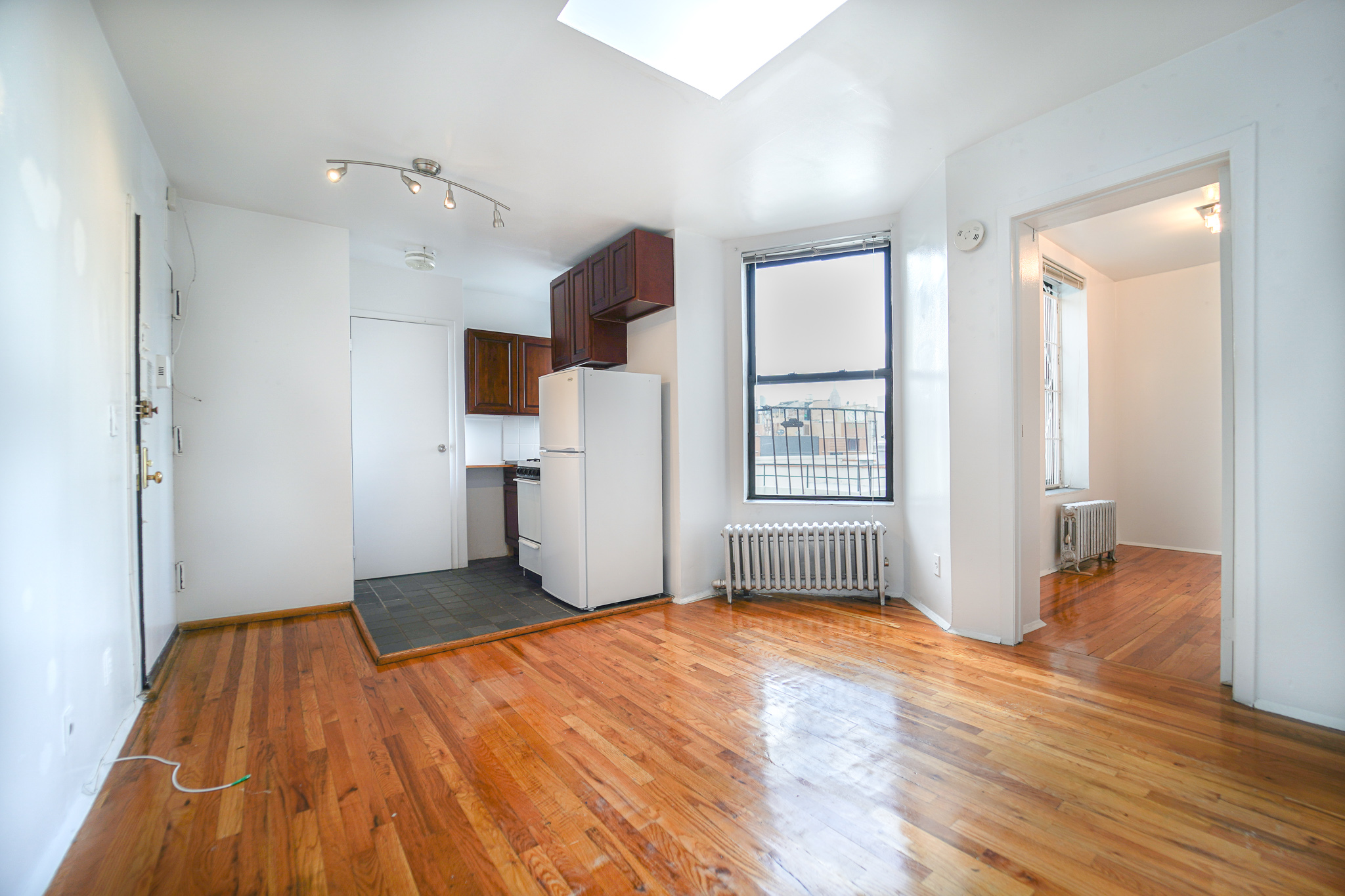 262 E 2 Street #6E - Super Bright One Bedroom in East Village!The unit features open kitchen, beautiful skylight, spacious bedroom with closet as well as windowed bathroom. Located on the top floor of a walk up building. Close to public transportation, shops and cafes! Rent: $2,250 /monthTerms: 12 - 12 MonthsAvailable: Immediate
