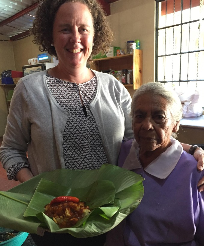 Gregoria and one of her famous paches - a tamale made from potatoes instead of corn flower.