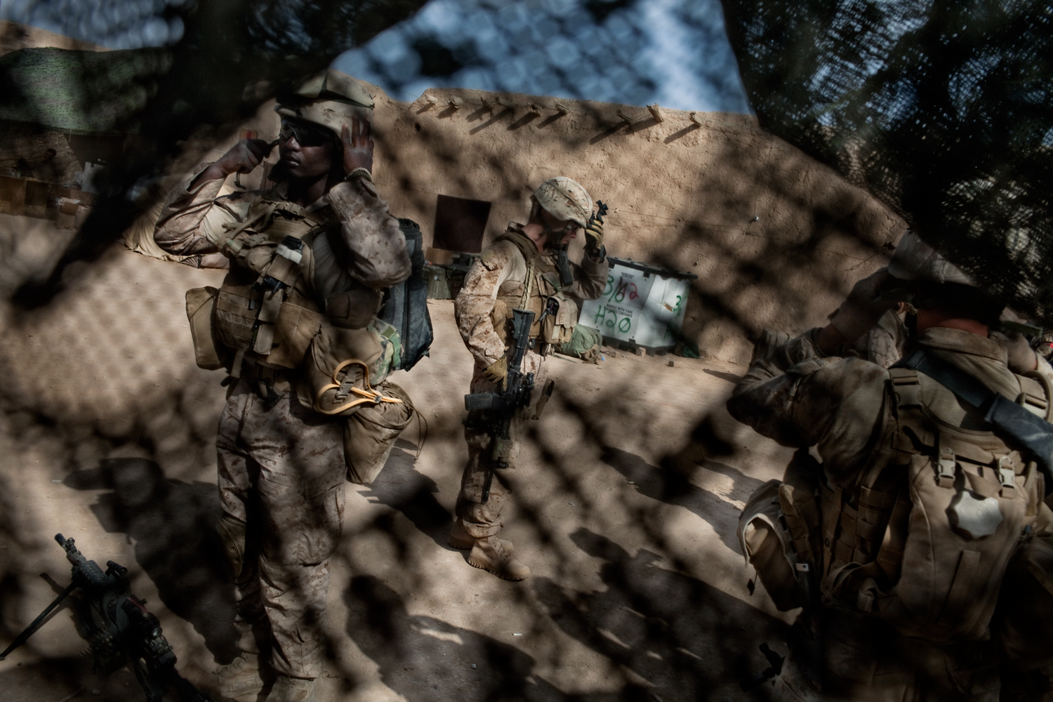 U.S. Marines prepare to depart Combat Operations Post Coutu for a patrol in Marja District, Helmand Province, Afghanistan.